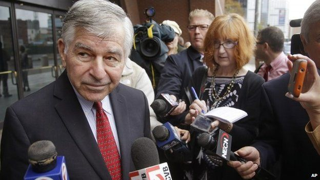Former Massachusetts Governor and Democratic presidential nominee Michael Dukakis talks to members of the media outside Federal Court after testifying in the Robel Phillipos trial 16 October 2014 in Boston