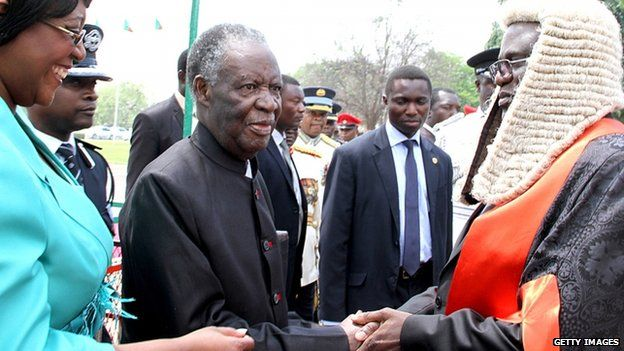 Michael Sata (2nd L) is welcomed by the Speaker of the National Assembly Dr Patrick Matibini (R) before officially opening the Zambian Parliament on September 19, 2014 in Lusaka.