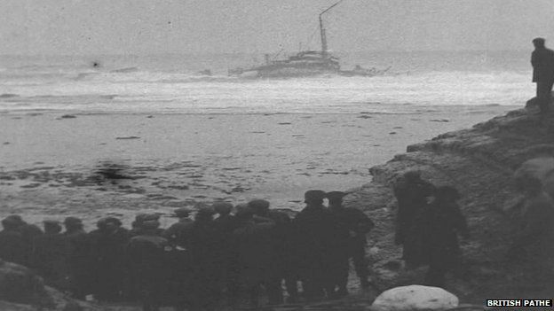 Crowds gather on the cliffs and watch in horror as the hospital ship Rohilla sinks