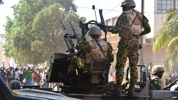 Burkina Faso troops try to disperse protesters in Ouagadougou on 30 October 2014