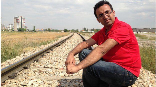Arsham Parsi on train tracks in Turkey