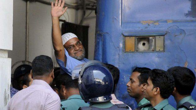 Mir Quasem Ali enters a van at the International Crimes Tribunal court in Dhaka, Bangladesh on 2 November 2014