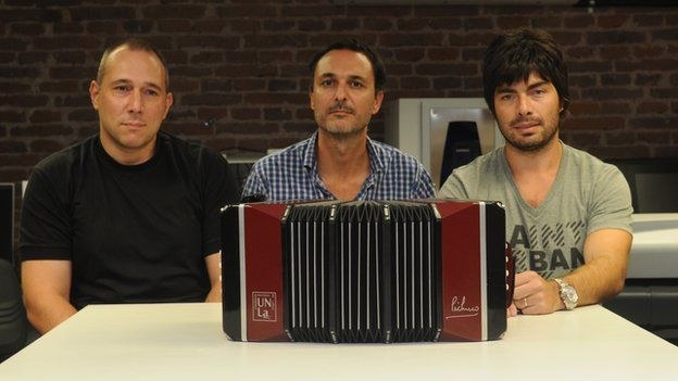 Andres Ruscitti (centre) and fellow members of the project team