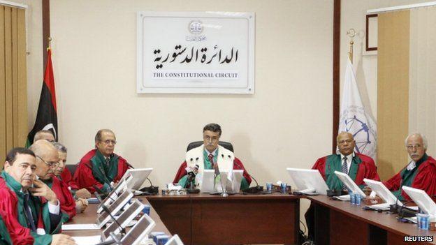 Judge Kamal Bashir Dahan (C), head of Libya's supreme court, meets with members of the constitutional chamber in Tripoli, Libya on 6 November 2014