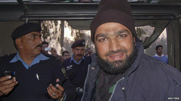 Malik Mumtaz Hussain Qadri smiles after being detained at the site of Salman Taseer's shooting in Islamabad, Pakistan on 4 January 2011