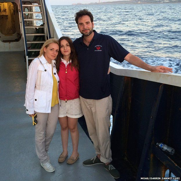 Regina and Christopher Catrambone with their daughter