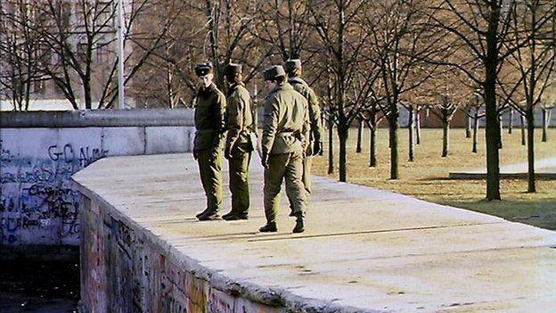 East German soldiers on the Berlin Wall in 1989