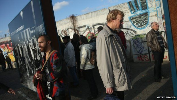 People stand by a remaining section of the Wall - 9 November