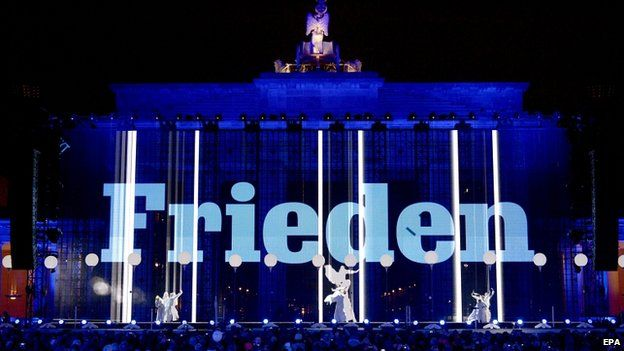 The word peace is projected on to the Brandenburg Gate, Berlin. 9 Nov 2014