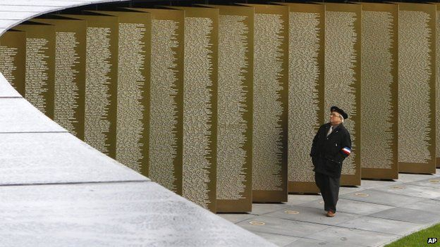 Man looks at the 580,000 names listed at the new memorial at Arras
