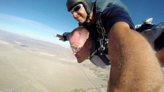 Kenny Heuer celebrating his divorce with a skydive