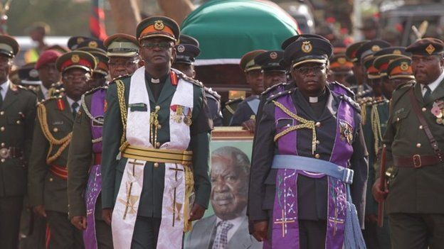 The coffin of the late Zambian President Michael Sata is draped in Zambia's flag at the funeral in Lusaka, Tuesday, 11 November 2014
