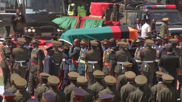 The coffin of the late Zambian president draped in Zambia's flag at the funeral in Lusaka, Tuesday 11 November 2014