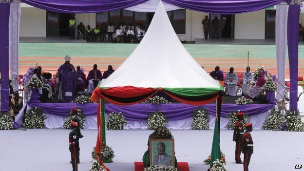 A portrait, centre, stands in front of the coffin of the late Zambian president at the funeral in Lusaka, Tuesday 11 November 2014