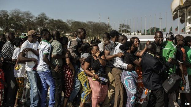 Zambians shove to access the Heroes stadium ahead of the late Zambian president Michael Sata's state funeral on 11 November 2014 in Lusaka
