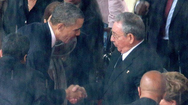 President Barack Obama shakes Raul Castro's hand at Nelson Mandela's funeral in South Africa.