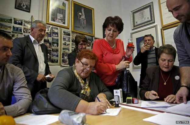 Representatives of Bosnian Muslim groups in Sarajevo sign a petition against the release of Mr Seselj, 12 November