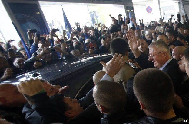Seselj supporters greet him at the airport in Belgrade, 12 November