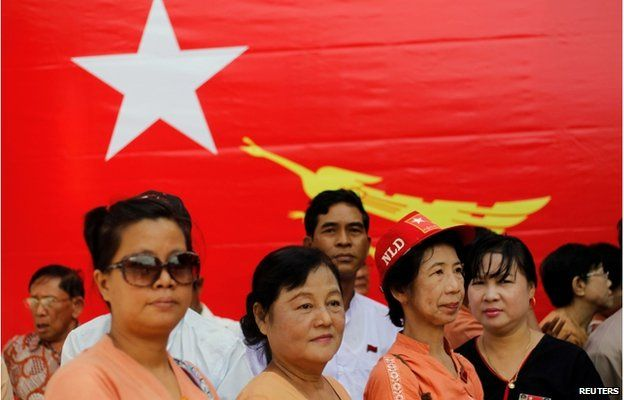 """Members of Myanmar""""s National League for Democracy (NLD) gather in front of their head office to celebrate the 26th anniversary their party's founding, in Yangon 27 September 2014"""