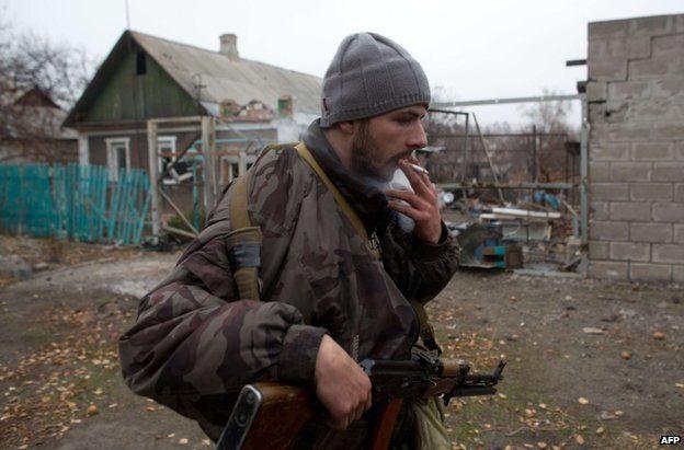 A pro-Russian rebel gunman on patrol in Donetsk, 13 November