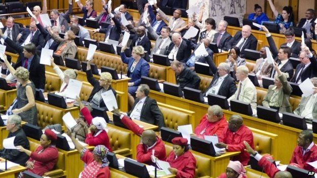 Members of the official opposition Democratic Alliance (DA) party on left and back, and members of the Economic Freedom Fighters (EFF) in red in parliament in Cape Town, South Africa - 13 November 2014