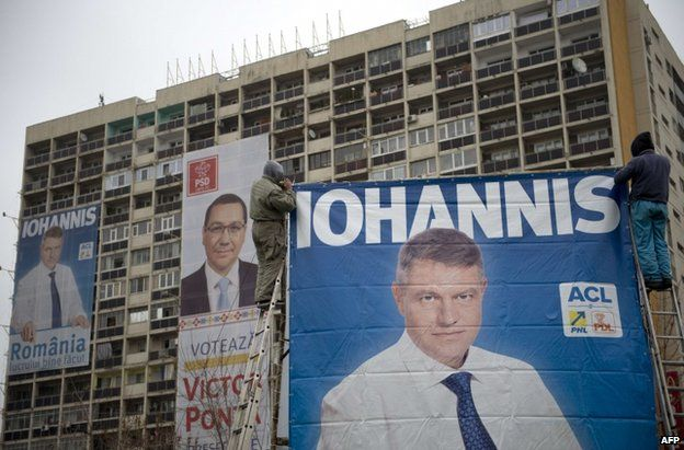 A poster of Victor Ponta between two of his rival Klaus Iohannis in Bucharest, 14 November
