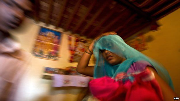 Alleged victim of human trafficking in India, leaving with her belongings after being rescued
