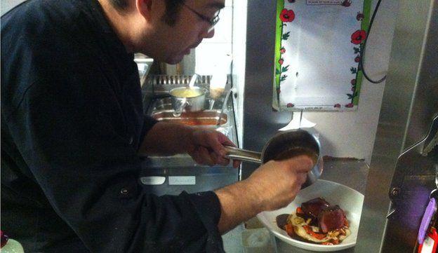Food is prepared at Christian Etchebest's restaurant La Cantine du Troquet Dupleix