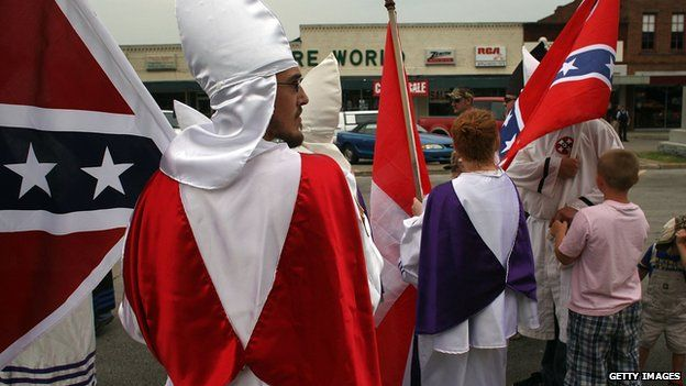 Members of the Fraternal White Knights of the Ku Klux Klan participate in the 11th Annual Nathan Bedford Forrest Birthday march July 11, 2009 in Pulaski, Tennessee