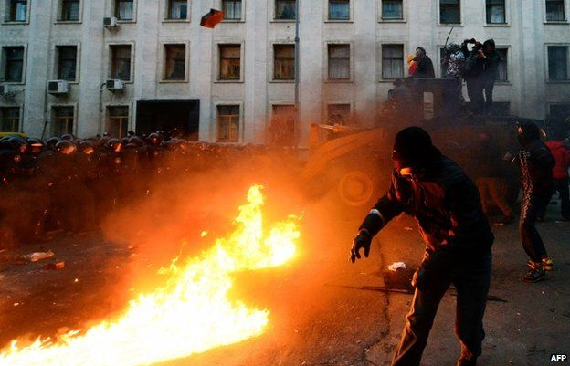 Riot police clash with protesters outside the presidential administration office in Kiev on 1 December 2013