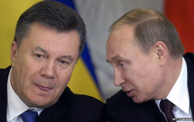 At a December signing ceremony with Mr Yanukovych, Russia's President Putin (R) slashed gas prices for Ukraine
