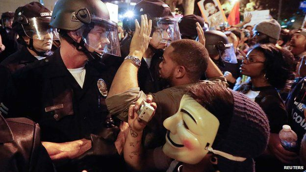 Protesters face off against a line of police in Los Angeles, California on 25 November 2014
