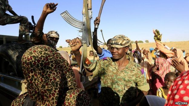 Women welcome a military convoy of government forces to Tabit in Darfur - 20 November 2014