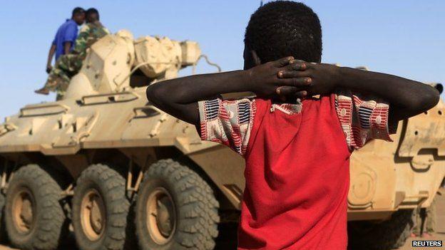 A boy looks on at a tank in Tabit, Darfur in Sudan 20 November 2014