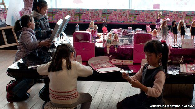Young girls sitting around a table in the Barbie Store in Shanghai in 2009