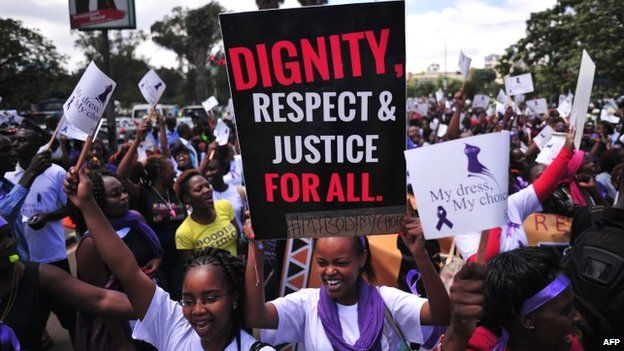 Women hold up placards and shout slogans during a rally against violence to women, on 17 November in Nairobi, Kenya
