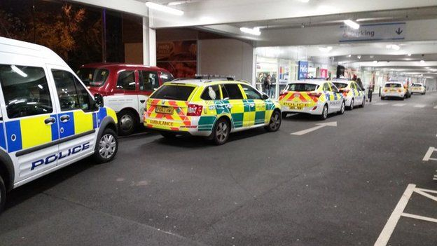 Police and ambulance vehicles outside a Tesco store
