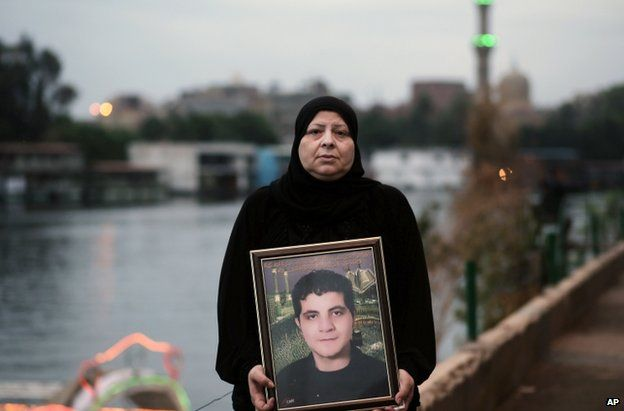 Amal Shaker with a photo of her son Ahmed, killed during the 2011 uprising, in Cairo, 25 November