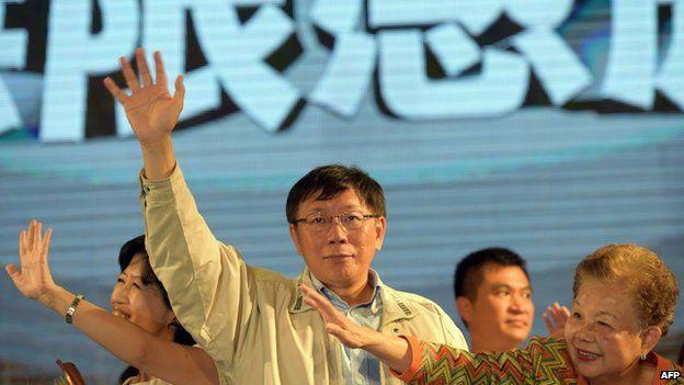 Taipei election winner Ko Wen-je waves in Taipei, 29 November