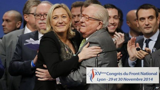 French Front National leader Marine Le Pen is kissed by her father Jean-Marie Le Pen after being re-elected as president of the party during the 15th congress of the party in Lyon, France in November 2014