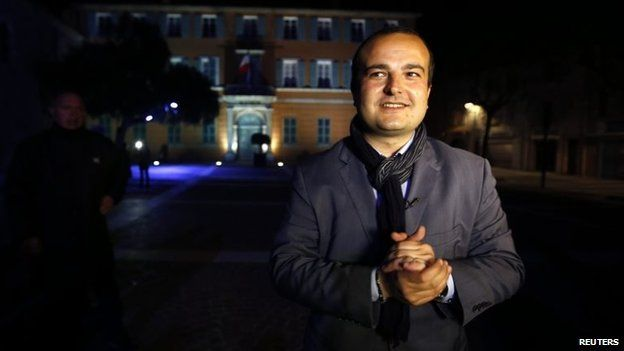 Mayoral candidate David Rachline poses in front of the town hall after winning the second round in the French mayoral elections in Frejus in March 2014