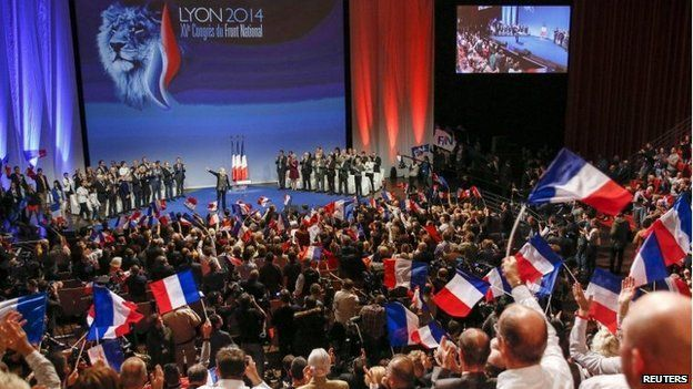 Marine Le Pen, France's National Front political party leader, gestures after delivering a speech at their congress in Lyon in November 2014