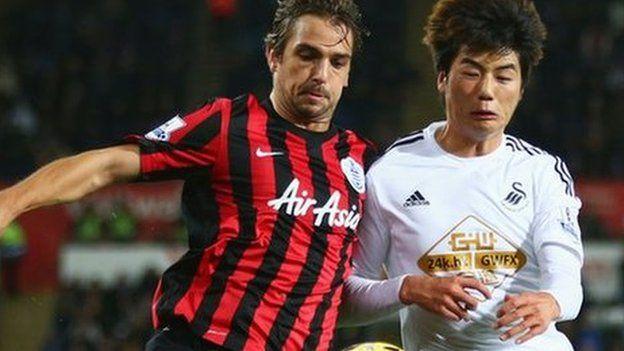 Niko Kranjcar of QPR battles with Ki Sung-Yueng