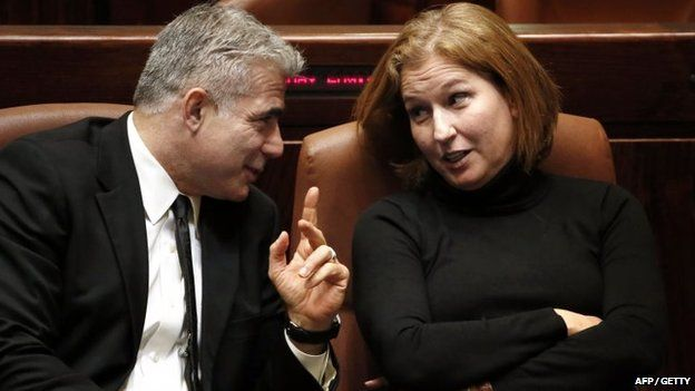Yair Lapid and Tzipi Livni chat at the Knesset in Jerusalem in December 2014