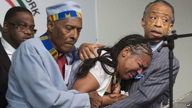 Esaw Garner, centre, wife of Eric Garner, breaks down in the arms of Rev Herbert Daughtry and Rev Al Sharpton