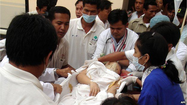 Cambodian pop singer Pov Panhapich is carried out of an ambulance at the Calmet hospital in Phnom Penh on 23 February, 2007