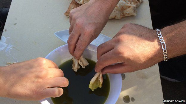Bread is dipped into olive oil from olives grown on the West Bank