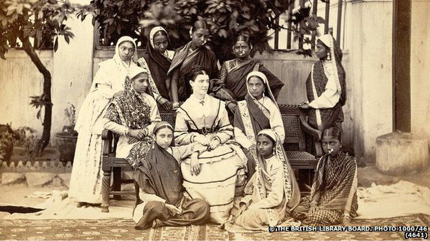 Photograph of a group posed in front of the Government Normal School at Bombay, in Maharashtra from the Archaeological Survey of India Collections
