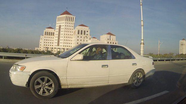 Policeman in Ashgabat driving while using his mobile (Nov 2014)