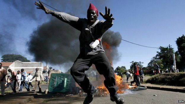 An opposition supporter jumps over a fire during a post-election violence in Nairobi, Kenya. Photo: 2008
